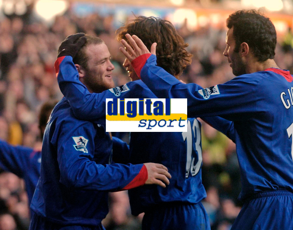 Photo: Glyn Thomas.<br />Aston Villa v Manchester United. The Barclays Premiership.<br />17/12/2005.<br />Manchester United's Wayne Rooney (L) celebrates his goal with Park Ji-Sung (C) and Ryan Giggs.