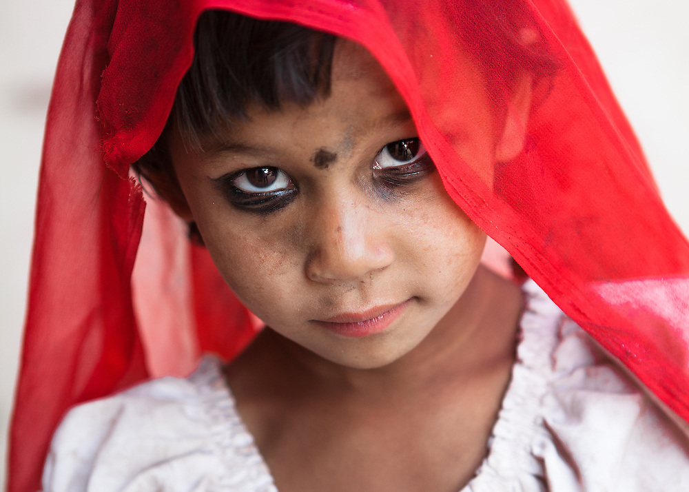 Sangita (6) walks through the devastated city of Bhaktapur, Nepal, during the aftermath of the earthquake on the 25th of April 2015. She's dressed up as a traditional Nepalese bride.