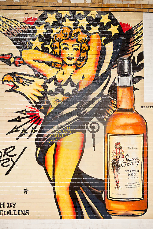 A advertisement for Sailor Jerry Spiced Rum painted on a wall in the hip neighborhood of Wicker Park in Chicago, IL, USA.