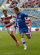 Jake Hessenthaler gets passed Mitchell Lund to advance goal wards during the Sky Bet League 1 match between Gillingham and Doncaster Rovers at the MEMS Priestfield Stadium, Gillingham, England on 5 September 2015. Photo by Andy Walter.