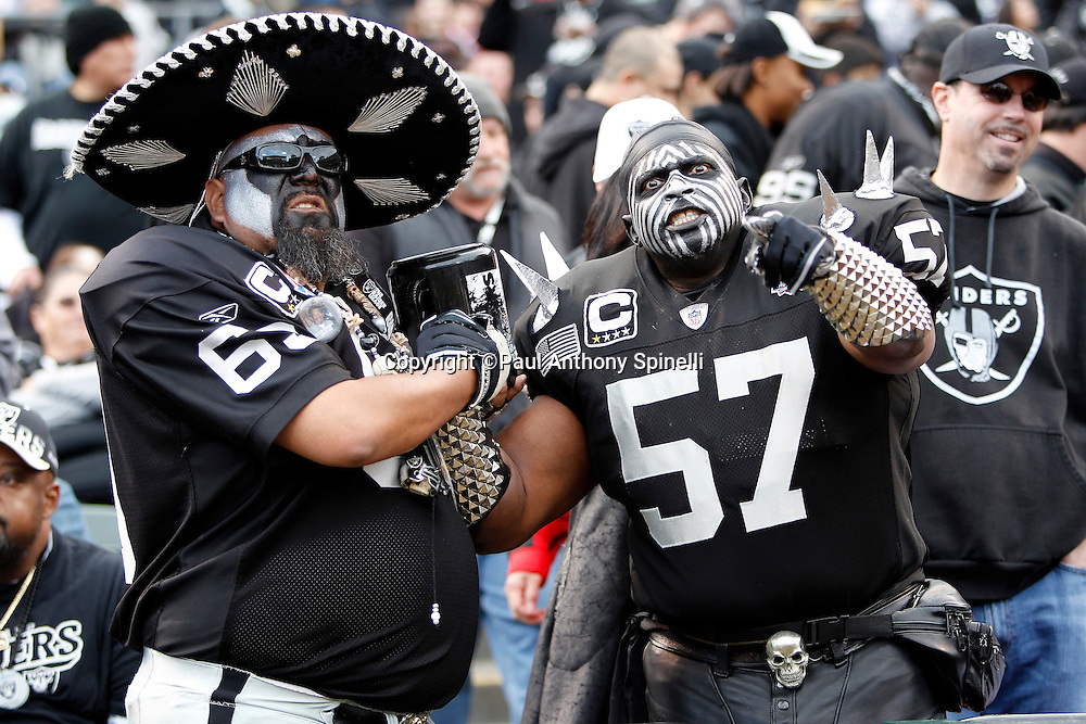 Two Oakland Raiders fans with wild costumes leer during the NFL week 16 football game against the Indianapolis Colts on Sunday, December 26, 2010 in Oakland, California. The Colts won the game 31-26. (©Paul Anthony Spinelli)