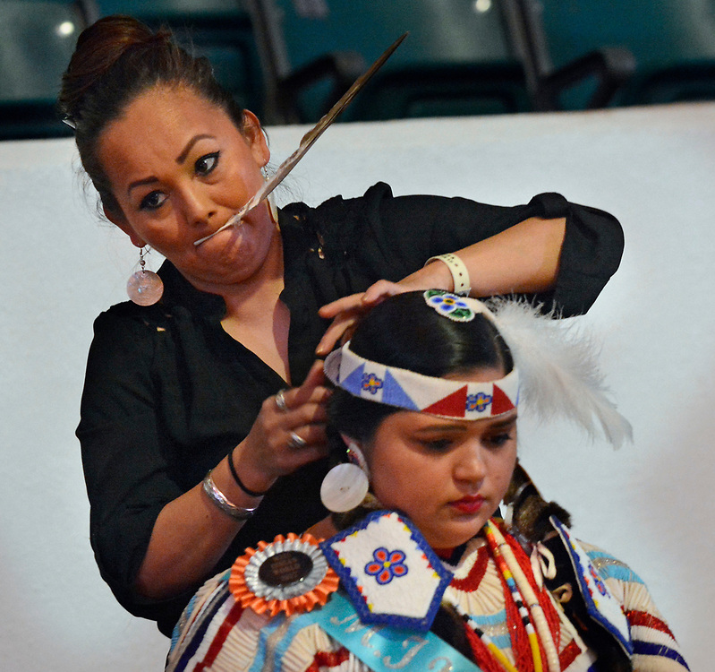 jt042817h/a sec/jim thompson/  Violet Olney of White Swan WA. of the Yakima Nation does her daughters hair Devalyn Crowe the 2017 Gathering of Nations Pow-Pow held at Tingley Coliseum.   Friday April 28, 2017. (Jim Thompson/Albuquerque Journal)