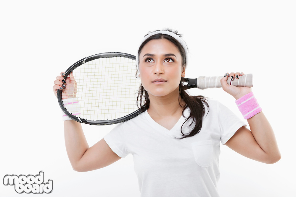 Young Asian woman holding tennis racket over white background