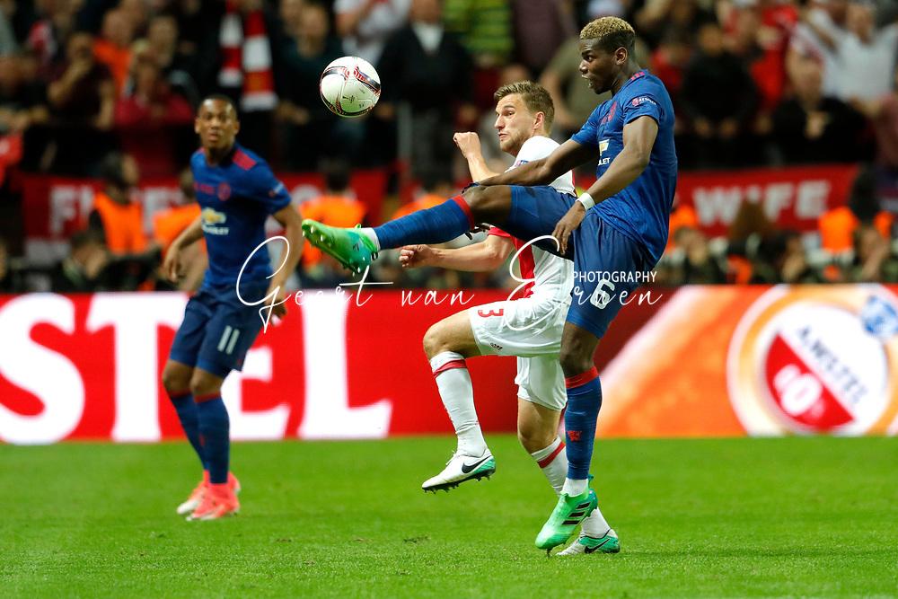 24-05-2017 VOETBAL:AJAX - MANCHESTER UNITED:FINALE:STOCKHOLM<br /> <br /> Paul Pogba van Manchester United  in duel met Jo&euml;l Veltman van Ajax <br /> <br /> Foto: Geert van Erven