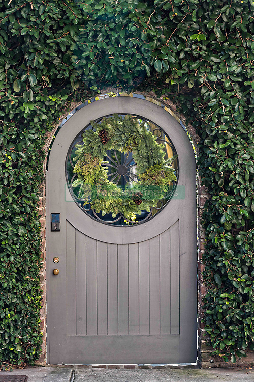 December 21, 2017 - Charleston, South Carolina, United States of America - A wooden gate with a Christmas wreath at a historic home on Tradd Street in Charleston, SC. (Credit Image: © Richard Ellis via ZUMA Wire)