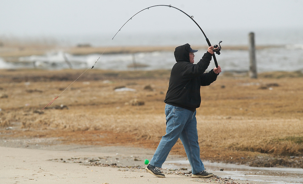 (PPAGE1) Union Beach 4/1/2004  Bob Deuchler of Union Beach launches his bait into the Raritan Bay from the beach of Union Beach.   Michael J. Treola Staff Photographer....MJT