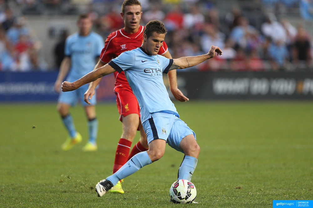Bruno Zuculini, (left), Manchester City, challenged by Jordan Henderson , Liverpool, during the Manchester City Vs Liverpool FC Guinness International Champions Cup match at Yankee Stadium, The Bronx, New York, USA. 30th July 2014. Photo Tim Clayton