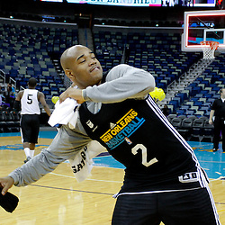 December 17, 2011; New Orleans, LA, USA; New Orleans Hornets point guard Jarrett Jack (2) throws a t-shirt into the stands following a team scrimmage at the New Orleans Arena.   Mandatory Credit: Derick E. Hingle-US PRESSWIRE