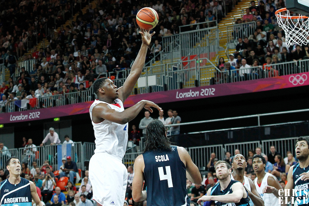 31 July 2012: Kevin Seraphin of France goes for the skyhook during 71-64 Team France victory over Team Argentina, during the men's basketball preliminary, at the Basketball Arena, in London, Great Britain.