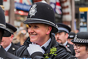 Police with Shamrocks -  the London St Patrick's Day parade from Piccadilly to Trafalgar Square.