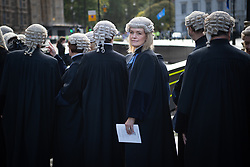 © Licensed to London News Pictures. 01/10/2019. London, UK. Judges Service, Westminster. Senior members of the Judiciary cross over puddles in a procession to the Houses of Parliament after a traditional service in Westminster Abbey marking the beginning of a new legal year. Photo credit: Guilhem Baker/LNP