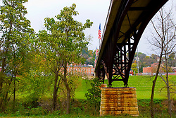 October 2009: scenic view of  bridge, railroad and Galena River in Galena Illinois. Sights to see in and around Galena Illinois. This image was produced in part utilizing High Dynamic Range (HDR) or panoramic stitching or other computer software manipulation processes. It should not be used editorially without being listed as an illustration or with a disclaimer. It may or may not be an accurate representation of the scene as originally photographed and the finished image is the creation of the photographer.