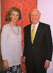 The High Commissioner of Australia MR PHILIP FLOOD and MRS FLOOD at an exhibition in London on 6th August 1998.MJI 4