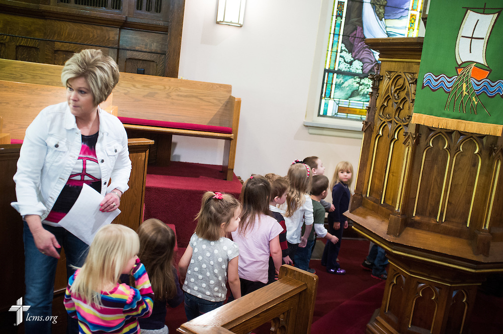 Pre-K teacher Karen Kellar leads her students to class from the sanctuary at Holy Cross Lutheran Church and School in Collinsville, Ill., on Friday, Feb. 21, 2014. LCMS Communications/Erik M. Lunsford