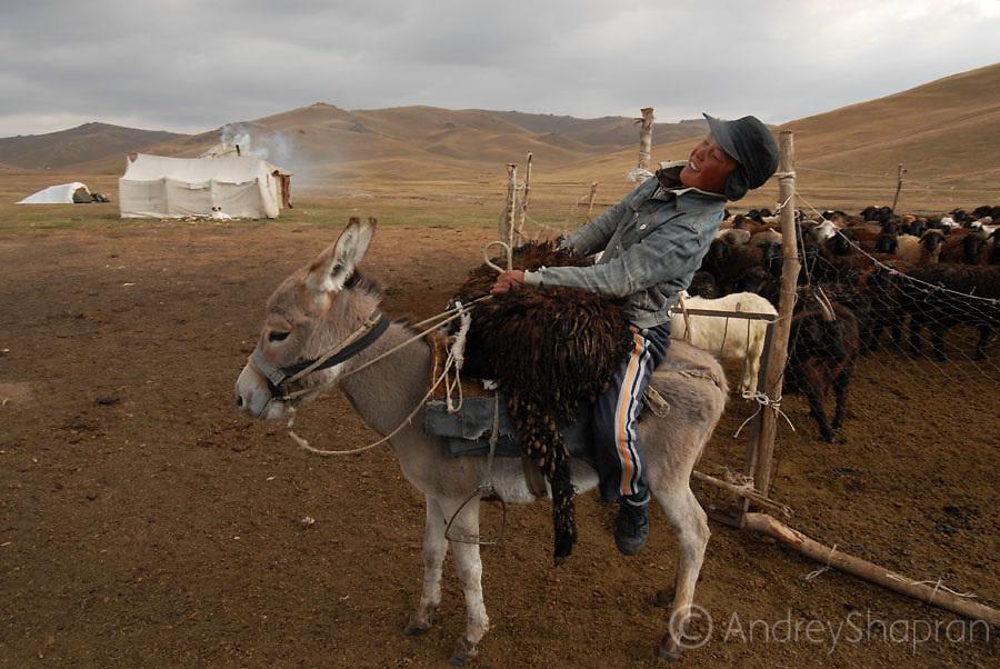 Riding a donkey. Song-Kul' lake