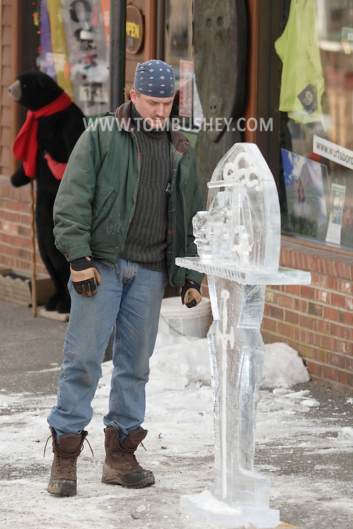 Wurtsboro, N.Y. - A man looks at an ice sculpture of a motorcycle on display at the Wurtsboro Winterfest on Feb. 10, 2007.