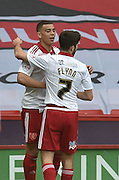 Sheffield United forward Che Adams (29) celebrates with Sheffield United midfielder Ryan Flynn (7) after scoring to go 1-0 up  during the Sky Bet League 1 match between Sheffield Utd and Crewe Alexandra at Bramall Lane, Sheffield, England on 25 March 2016. Photo by Ian Lyall.