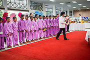 26 NOVEMBER 2012 - BANGKOK, THAILAND:   Muslim school children present gifts to the Thai monarchy at Siriraj Hospital in Bangkok. Siriraj was the first hospital in Thailand and was founded by King Chulalongkorn in 1888. It is named after the king's 18-month old son, Prince Siriraj Kakuttaphan, who had died from dysentery a year before the opening of the hospital. It's reported to one of the best hospitals in Thailand and has been home to Bhumibol Adulyadej, the King of Thailand, since 2009, when he was hospitalized to treat several ailments. Since his hospitalization tens of thousands of people have come to pay respects and offer get well wishes. The King's 85th birthday is on Dec 5 and crowds at the hospital are growing as his birthday approaches. The King is much revered throughout Thailand and is seen as unifying force in the politically fractured country.      PHOTO BY JACK KURTZ