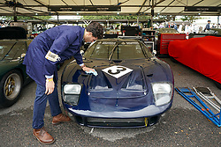 © Licensed to London News Pictures. <br /> 13/09/2019. <br /> Goodwood.West, Sussex. UK.<br /> The Goodwood Motor Circuit celebrates the 21st year of the Revival.This has become one of the biggest annual historic motorsport events in the world and the only one to be staged entirely in period dress. Each year over 150,000 people descend on this quiet corner of West Sussex to enjoy the three-day event.<br /> Pictured. A mechanic polishing a Ford GT40<br /> Photo credit: Ian Whittaker/LNP