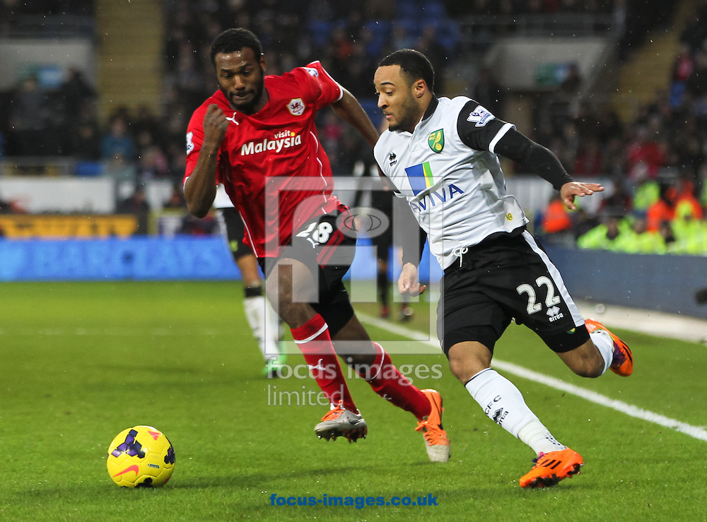 Picture by Tom Smith/Focus Images Ltd 07545141164<br /> 01/02/2014<br /> Nathan Redmond (right) of Norwich City takes the ball past K&eacute;vin Theophile Catherine (left) during the Barclays Premier League match at the Cardiff City Stadium, Cardiff.