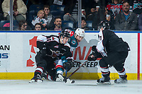 KELOWNA, CANADA - MARCH 7: Davis Koch #16 of the Vancouver Giants checks Cal Foote #25 of the Kelowna Rockets into the boards during second period  on March 7, 2018 at Prospera Place in Kelowna, British Columbia, Canada.  (Photo by Marissa Baecker/Shoot the Breeze)  *** Local Caption ***