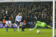 Everton striker Cenk Tosun (14) scores a goal past Millwall goalkeeper Jordan Archer (1) during the The FA Cup fourth round match between Millwall and Everton at The Den, London, England on 26 January 2019.