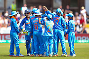 India celebrate the wicket of England womens cricket Tammy Beaumont (wk)  caught by India womens cricket Smriti Mandhana   during the ICC Women's World Cup match between England and India at the 3aaa County Ground, Derby, United Kingdom on 24 June 2017. Photo by Simon Davies.