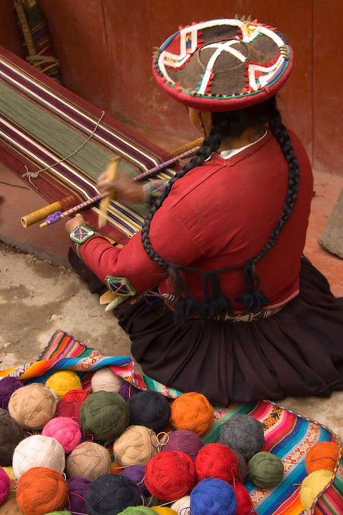 South America, Peru, Chinchero (near Cuzco), woman weaving using backstrap loom.  MR