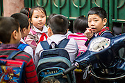 09 APRIL 2012 - HANOI, VIETNAM:  School children wait in line in front of their school in Hanoi, the capital of Vietnam. Hanoi, established in 1010 AD, is one of the oldest permanent cities in Southeast Asia. PHOTO BY JACK KURTZ