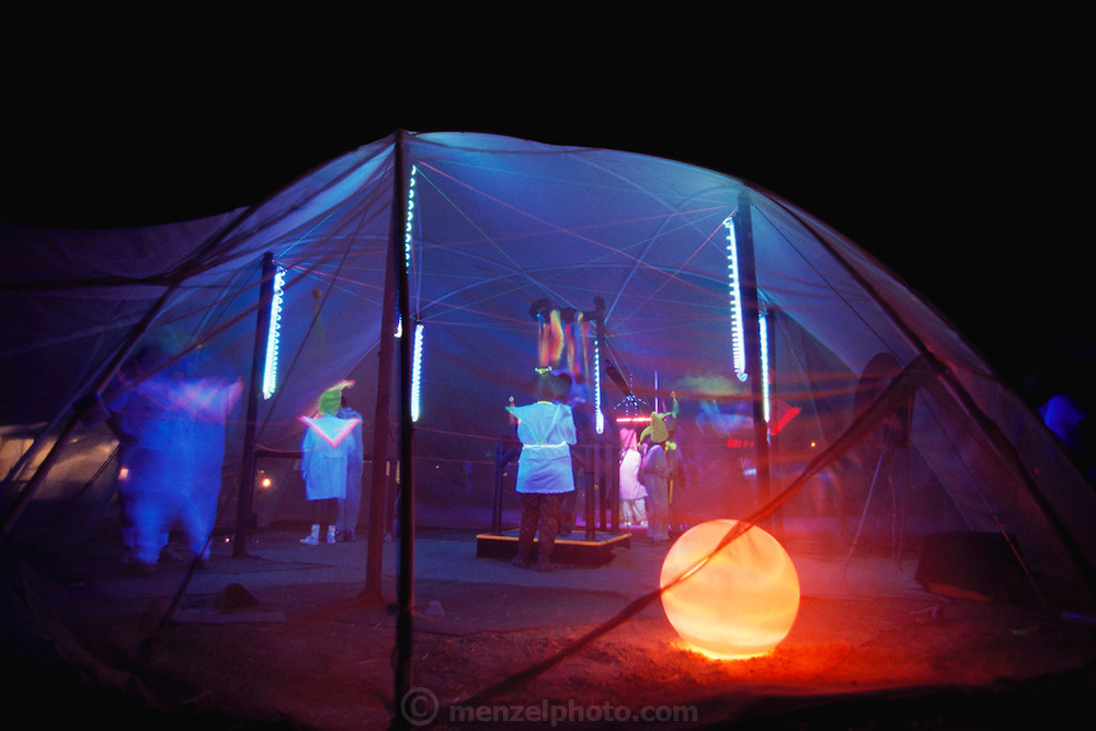 Black Rock Desert, Nevada.One of the many futuristic art-themed camps at dusk at the Burning Man Festival burn. Burning Man is the art, drugs and sex festival based on radical self-expression and creative community held annually in the Black Rock Desert near Gerlach, Nevada, USA.
