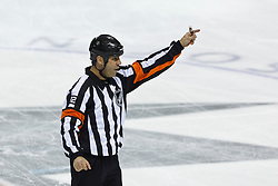 Mar 31, 2012; San Jose, CA, USA; NHL referee Justin St. Pierre (12) signals during a stoppage in play between the San Jose Sharks and the Dallas Stars during the first period at HP Pavilion. San Jose defeated Dallas 3-0. Mandatory Credit: Jason O. Watson-US PRESSWIRE