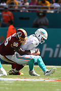 Sunday, October 13, 2019; Miami Gardens, FL USA;  Washington Redskins defensive tackle Treyvon Hester (96) sacks Miami Dolphins quarterback Josh Rosen (3) during an NFL game at Hard Rock Stadium. The Redskins beat the Dolphins 17-16. (Kim Hukari/Image of Sport)