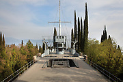 Deck of the Regia Nave Puglia, a warship, set into the Mastio hill, at Vittoriale degli italiani, or The Shrine of Italian Victories, the home, estate and museums of Gabriele D'Annunzio, 1863-1938, Italian writer, soldier and fascist, at Gardone Riviera, Lake Garda, Brescia, Lombardy, Italy. The ship was a gift from Admiral Thaon di Revel in 1923, in memory of captain Tommaso Gulli, who died in the waters of Split in 1920. Inside the ship is the Onboard Museum, opened 2002, with models of warships belonging to Duke Amedeo d'Aosta. The estate consists of the Prioria, where d'Annunzio lived 1922-38, an amphitheatre, the protected cruiser Puglia, the MAS vessel used by D'Annunzio in 1918 and a mausoleum. It is part of the Grandi Giardini Italiani. Picture by Manuel Cohen