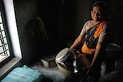 Woman at work in a kitchen in South India.