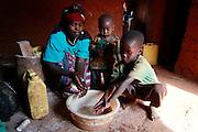 Mother - Patricia Umariya, Elisa Niyonsenga, Jean Damacene, wash hands with water collect from the river 2 km's away before lunch. Gatora village, Bugesera district. Rwanda. Picture: WaterAid / Zute Lightfoot