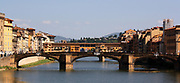 The Ponte Vecchio or 'Old Bridge', a Medieval stone bridge over the Arno River in Florence, Italy. It is a closed-spandrel segmental arch bridge. The bridge is famous for having shops built along it, originally butchers, but now souvenir shops, jewellers, and art dealers reside in the shops.