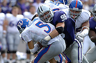 MANHATTAN, KS - OCTOBER 06:  Linebacker Ian Campbell of the Kansas State Wildcats sacks quarterback Todd Reesing #5 of the Kansas Jayhawks in the third quarter, during a NCAA football game on October 6, 2007 at Bill Snyder Snyder Stadium in Manhattan, Kansas.  Kansas won 30-24.  (Photo by Peter Aiken/Getty Images)