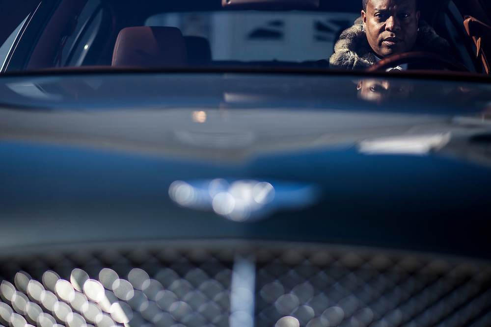Accokeek, Maryland - February 19, 2015: Rodney Foster drives a Bentley and wears Bentley. The luxury car brand also makes fragrances. Mr. Foster bought the fragrance before smelling it, and says he loves it. Bentley is following a trend among luxury auto makers who are venturing into fashion and accessories. <br /> <br /> CREDIT: Matt Roth for The New York Times<br /> Assignment ID: 30170991A
