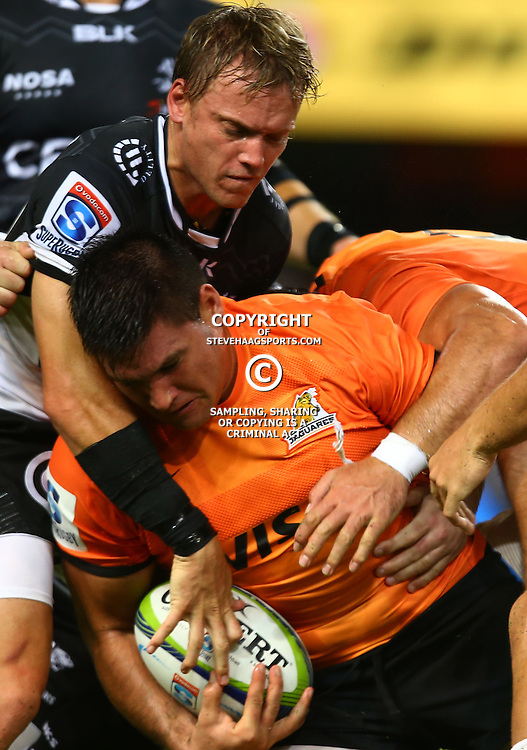 DURBAN, SOUTH AFRICA - MARCH 05:  Joe Pietersen of the Cell C Sharks tackling Felipe Arregui of the Jaguares during the 2016 Super Rugby match between Cell C Sharks and Jaguares at Growthpoint Kings Park Stadium on March 05, 2016 in Durban, South Africa. (Photo by Steve Haag/Gallo Images)