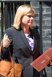 Downing Street, London, June 16th 2015. Justine Greening, Secretary of State for International Development leaves 10 Downing Street.