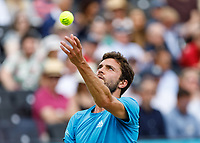 Tennis - 2019 Queen's Club Fever-Tree Championships - Day Six, Saturday<br /> <br /> Men's Singles, Semi Final: Daniil Medvedev (RUS) Vs. Gilles Simon (FRA) <br /> <br /> Gilles Simon (FRA) serving on Centre Court.<br />  <br /> COLORSPORT/DANIEL BEARHAM