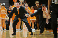 Jan 13, 2015; Knoxville, TN, USA; Tennessee Volunteers head coach Donnie Tyndall is restrained by director of basketball operations Justin Phelps during the game against the Arkansas Razorbacks at Thompson-Boling Arena. Tennessee won 74 to 69. Mandatory Credit: Randy Sartin-USA TODAY Sports