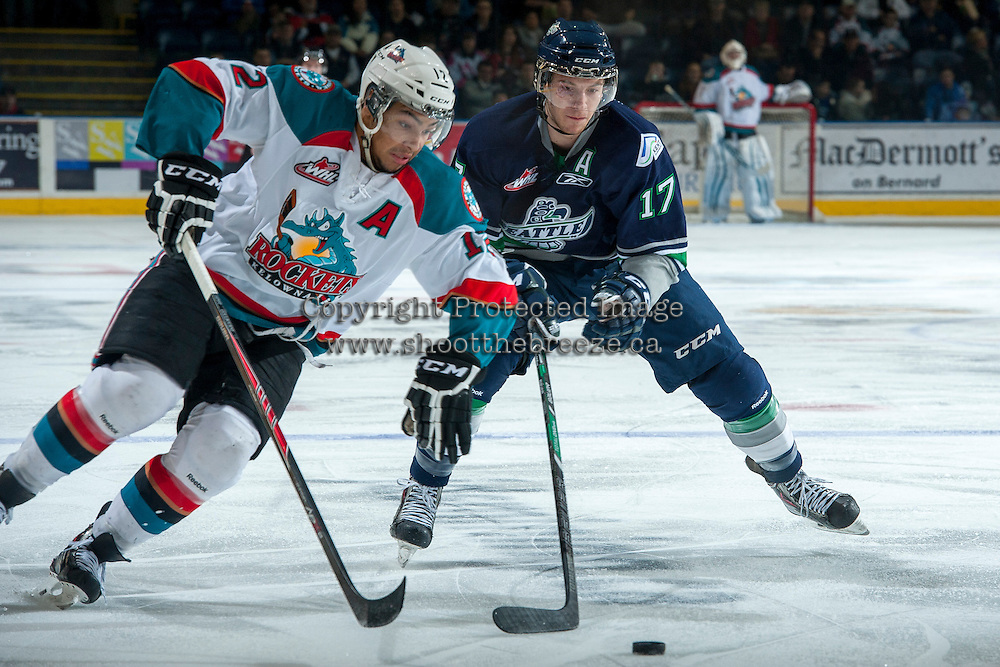 KELOWNA, CANADA -FEBRUARY 10: Shea Theodore #17 of the Seattle Thunderbirds stick checks Tyrell Goulbourne #12 of the Kelowna Rockets during first period on February 10, 2014 at Prospera Place in Kelowna, British Columbia, Canada.   (Photo by Marissa Baecker/Getty Images)  *** Local Caption *** Tyrell Goulbourne; Shea Theodore;