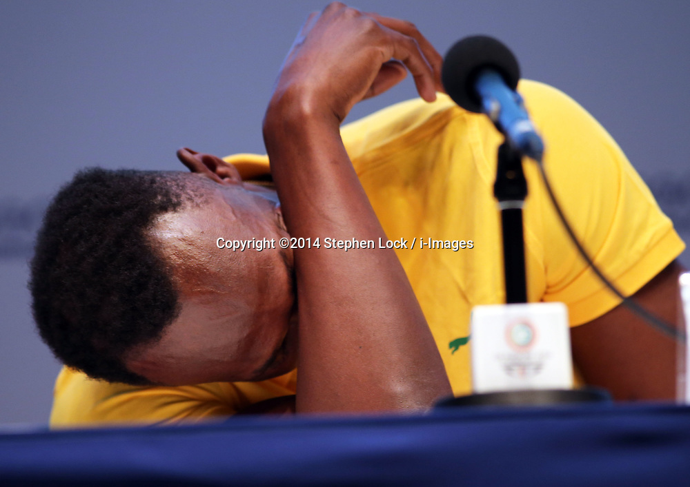 Image licensed to i-Images Picture Agency. 26/07/2014. Glasgow, United Kingdom. Usain Bolt  reacts to a question at a press conference on day three of the Commonwealth Games in Glasgow where he confirmed his attendance in the Relay event at the Games .   Picture by Stephen Lock / i-Images