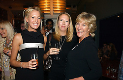 Left to right, sisters the HON.SOPHIA HESKETH and the HON.FLORA HESKETH with ANNABEL ELLIOT sister of HRH The Duchess of Cornwall at a party to celebrate the publication of 'The year of Eating Dangerously' by Tom Parker Bowles held at Kensington Place, 201 Kensington Church Street, London on 12th october 2006.<br />
