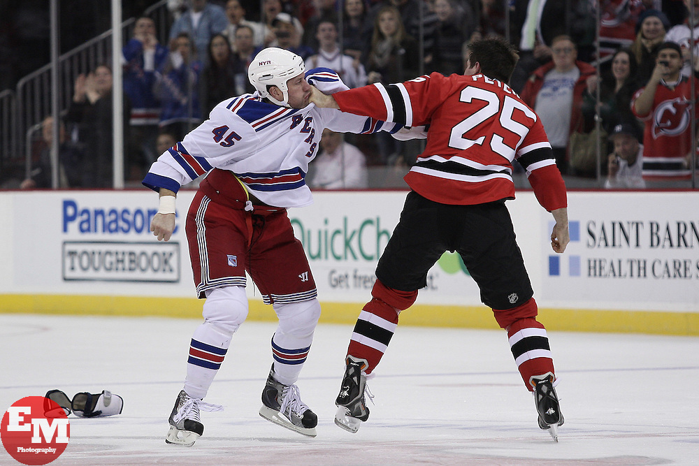 Mar 25, 2010; Newark, NJ, USA; New Jersey Devils left wing Andrew Peters (25) and New York Rangers left wing Jody Shelley (45) fight during the first period at the Prudential Center.