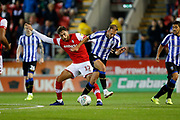 Matt Crooks of Rotherham United challenges Jordan Rhodes of Sheffield Wednesday during the EFL Cup match between Rotherham United and Sheffield Wednesday at the AESSEAL New York Stadium, Rotherham, England on 28 August 2019.
