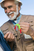Middle-Aged Fisherman with Spin Bait