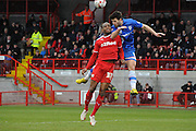 Aaron Morris heads clear the danger during the Sky Bet League 1 match between Crawley Town and Gillingham at the Checkatrade.com Stadium, Crawley, England on 28 March 2015. Photo by Michael Hulf.