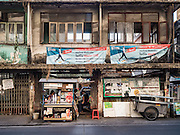 30 DECEMBER 2015 - BANGKOK, THAILAND: A woman operates a coffee stand in a condemned building in Bang Chak Market. The market is supposed to close permanently on Dec 31, 2015. The Bang Chak Market serves the community around Sois 91-97 on Sukhumvit Road in the Bangkok suburbs. About half of the market has been torn down. Bangkok city authorities put up notices in late November that the market would be closed by January 1, 2016 and redevelopment would start shortly after that. Market vendors said condominiums are being built on the land.           PHOTO BY JACK KURTZ